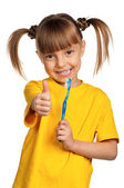 Girl with tooth brush — Stockfoto