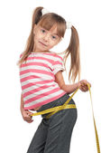 Little girl with measure — Stock Photo
