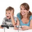 Happy family playing a video game — Stock Photo #9359266