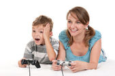 Happy family playing a video game — Photo