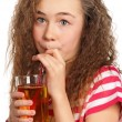 Girl with apple juice — Stock Photo