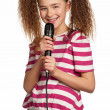 Girl with microphone - Stok fotoraf