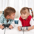 Royalty-Free Stock Photo: Happy girl and boy playing a video game