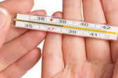 Hand with thermometer — Stock Photo