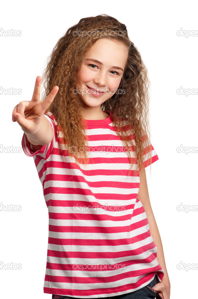 Portrait of happy girl showing victory hand sign isolated on white background — Stock Photo #9664476
