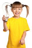 Girl with light bulb — Stock Photo