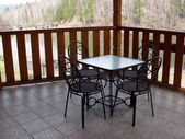 Metal table and four chairs in the balcony — Photo