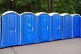 Row of blue public toilets in Moscow park — Stock Photo