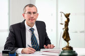 Lawyer on his workplace — Stockfoto