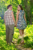 Happy Young Couple walking Outdoor — Stock Photo