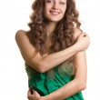 Happy young woman hugging herself — Stock Photo #8566699
