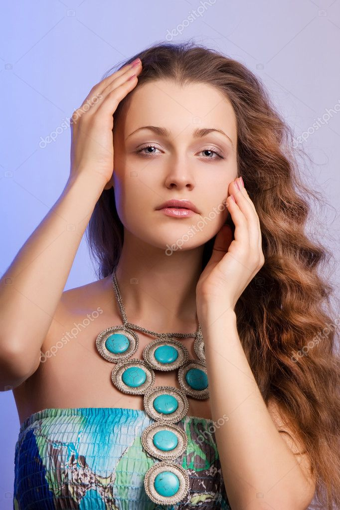 Pure female young beauty on purple background — Stock Photo #8567356
