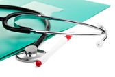 Stethoscope, pen and green folder for documents — Stock Photo