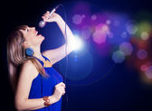 Portrait of young beautiful girl singing — Stock Photo