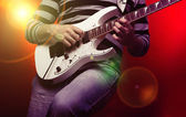 Young male musician with a white guitar — Foto de Stock
