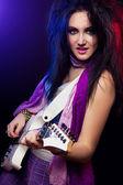 Fashion girl with guitar playing hard rock — Stock Photo