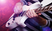 Young male musician with a white guitar — Stock Photo