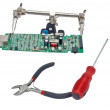 Circuit board with screwdriver - Stock Photo