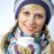 Beautiful woman with a white cup — Stock Photo #9899964