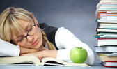 Tiredness student in library — Stock Photo