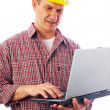 Handsome man-builder with laptop — Stock Photo #9900009