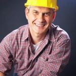 Builder on a dark background — Stock Photo