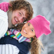 Young playful couple has a fun winter time in a snow park — Stock Photo