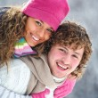 Young pair in winter park — Stock Photo