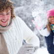 Couple playing snowballs — Stock Photo #9900342