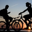 Two bicycler on sunset — Stock Photo