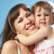 Portrait of young mother with her daughter — Stock Photo