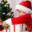 The small child presses to itself a beautiful gift — Stock Photo