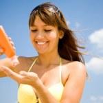 Woman in bikini smear protective cream — Stock Photo #9902830