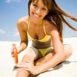 Woman in bikini smear protective cream — Stock Photo #9902835