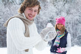 Couple playing snowballs — Stock Photo