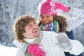 Couple playing snowballs — Stock Photo
