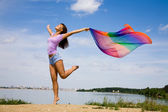 Beautiful young Woman enjoy and jumping on the beach — Stock Photo
