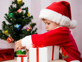 The small child presses to itself a beautiful gift — Foto Stock