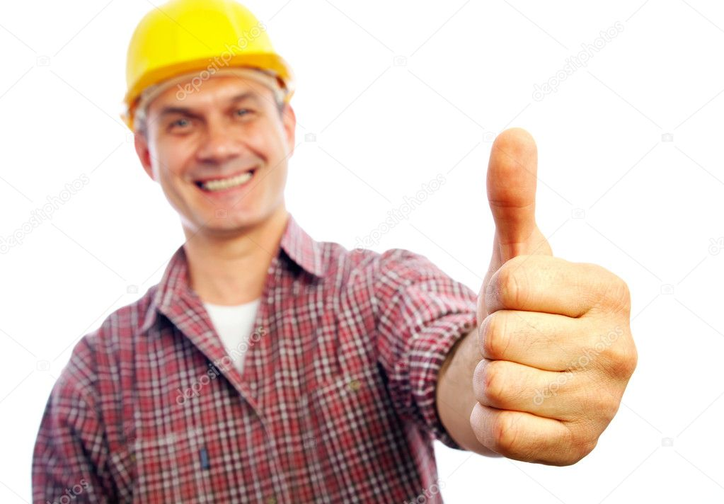 Handsome man builder smiles and shows a gesture OK  Stock Photo #9900032