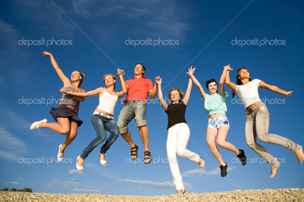 Group of happy young dancing at the beach on beautiful summer day  Stock Photo #9900939