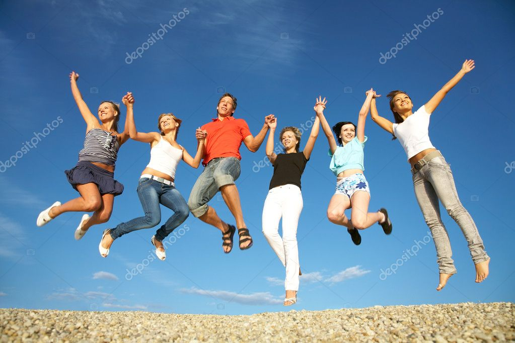 Group of happy young dancing at the beach on beautiful summer day — Stock Photo #9900943
