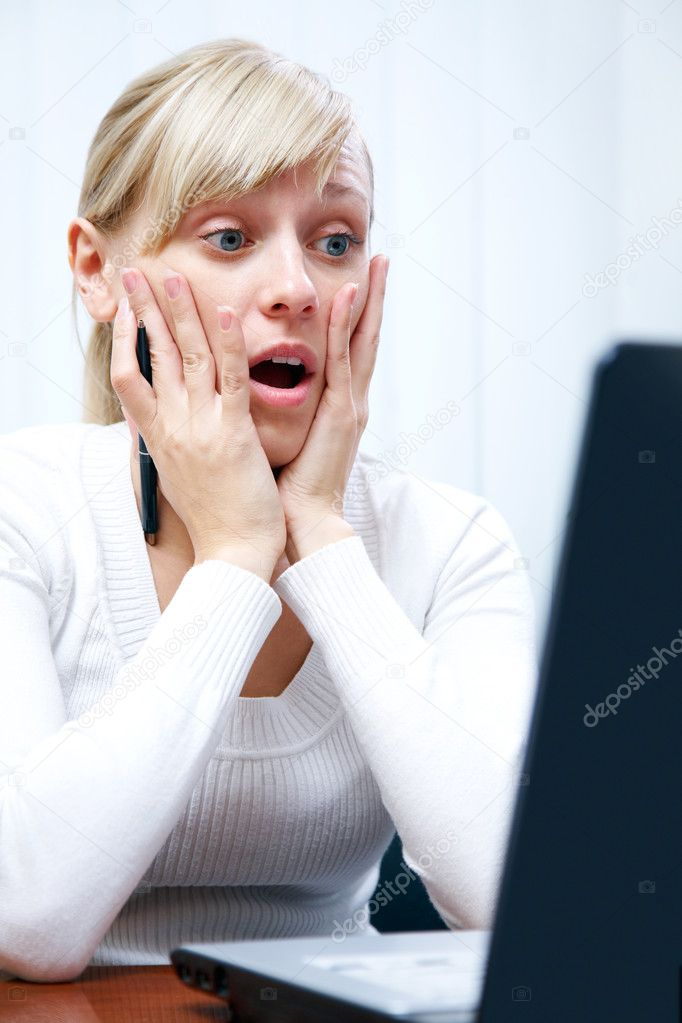 Young white woman was surprised at work at the computer — Stok fotoğraf #9902296