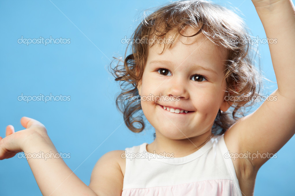 Portrait of funny lovely little girl on the blue background — Stock Photo #9902769