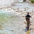 Fisherman in the Soca river, Slovenia — Stock Photo #10648050