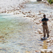 Fisherman in the Soca river, Slovenia — Stock Photo