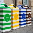 Four containers for recycling paper, metal, plastic and glass — Stock Photo