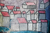 Graffiti, houses painted on the wall — Stock Photo