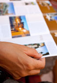 Woman reading a brochure — Stock Photo