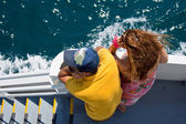 Lovers looking the sea on a ferry boat — Stock Photo