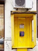 Yellow public telephones — Stock Photo